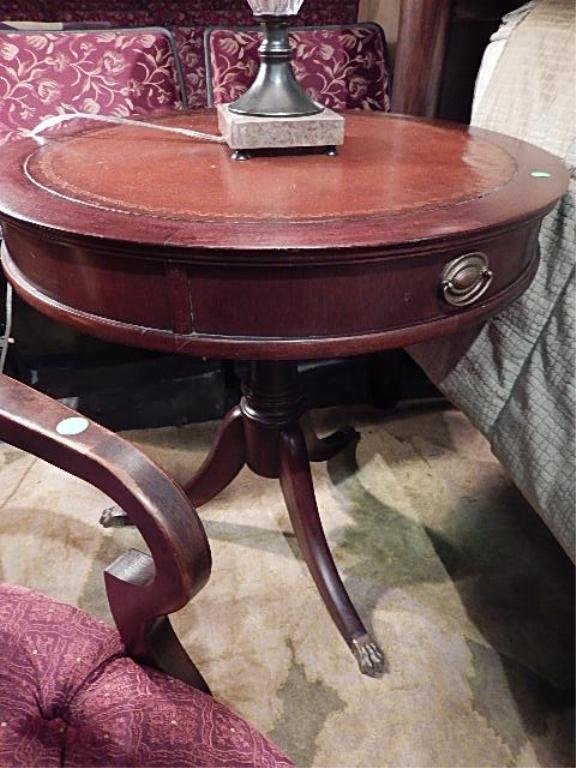 MAHOGANY PEDESTAL TABLE, LEATHER TOP, BRASS PULLS AND