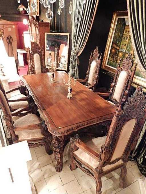 RICHLY CARVED DINING TABLE WITH LIONS HEAD LEGS AND 6