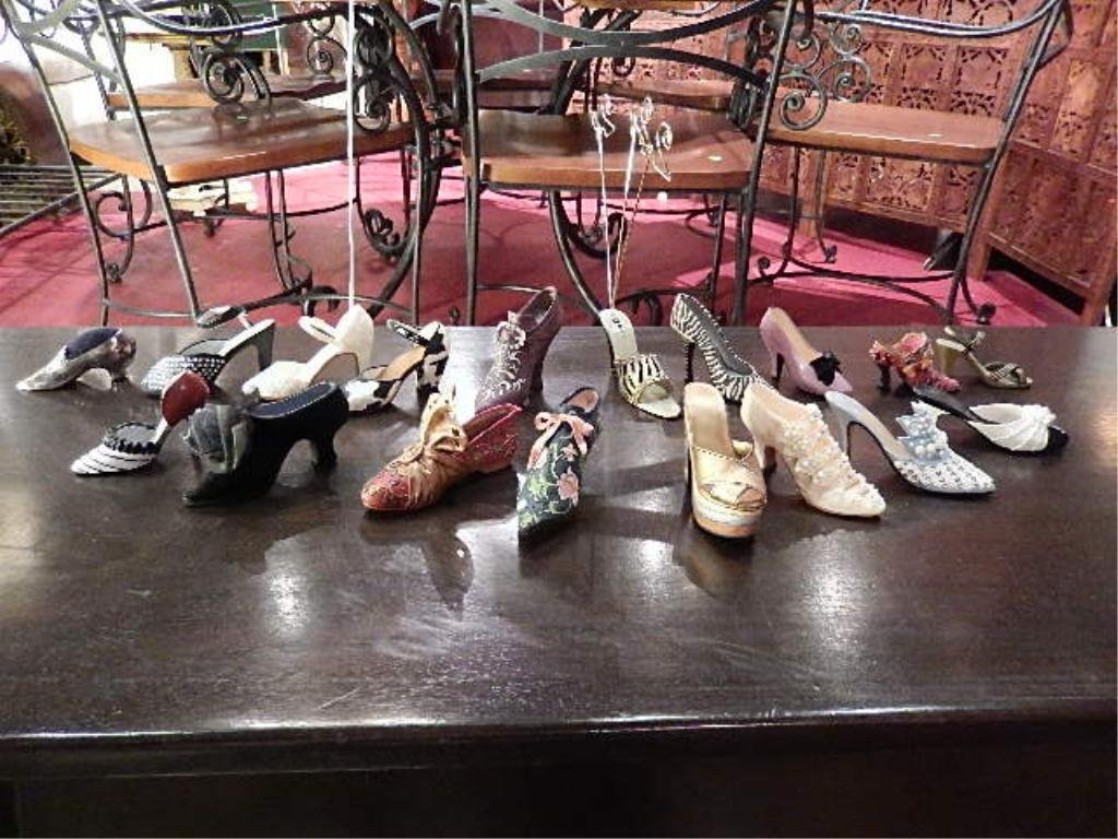 18 COLLECTIBLE SHOE FIGURINES, SOLD AS A GROUP