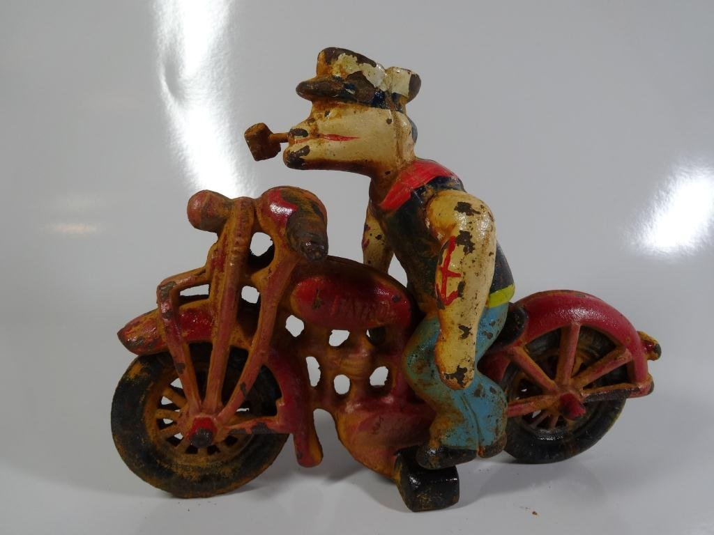 PAINTED CAST IRON POPEYE RIDING A MOTORCYCLE
