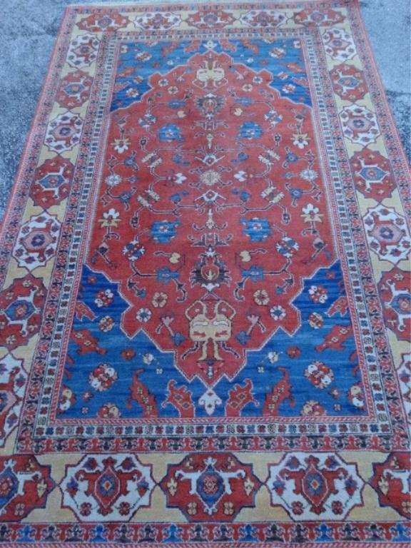 KARASTAN WOOL RUG, RED AND BLUE CENTER WITH BEIGE