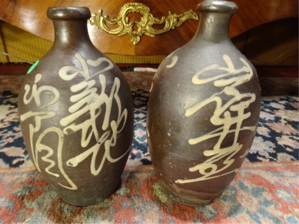 TWO BROWN STONEWARE VASES WITH CREAM CALLIGRAPHY,