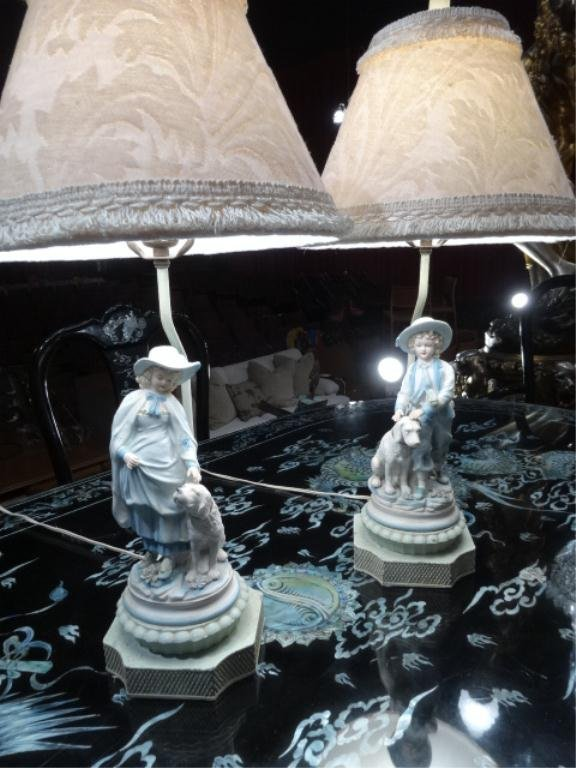 PAIR PORCELAIN FIGURAL LAMPS, GIRL AND BOY WITH DOGS,