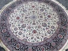 LARGE ROUND PERSIAN STYLE WOOL RUG, IVORY FIELD WITH