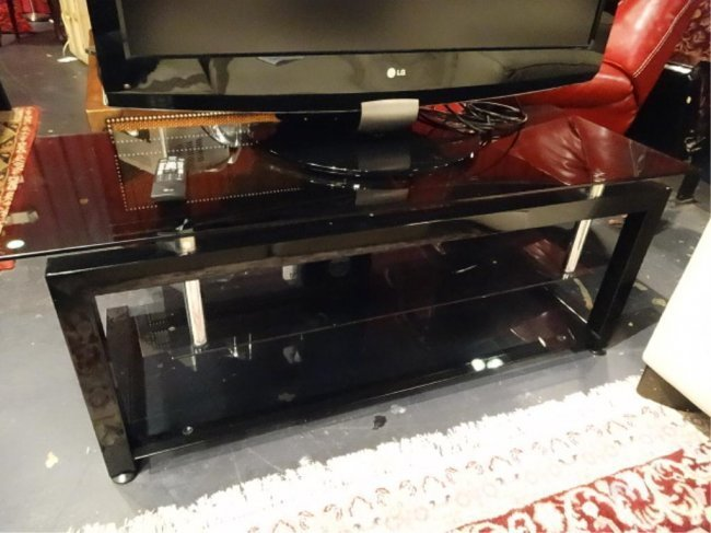 MODERN TV CONSOLE. BLACK METAL AND GLASS WITH CHROME
