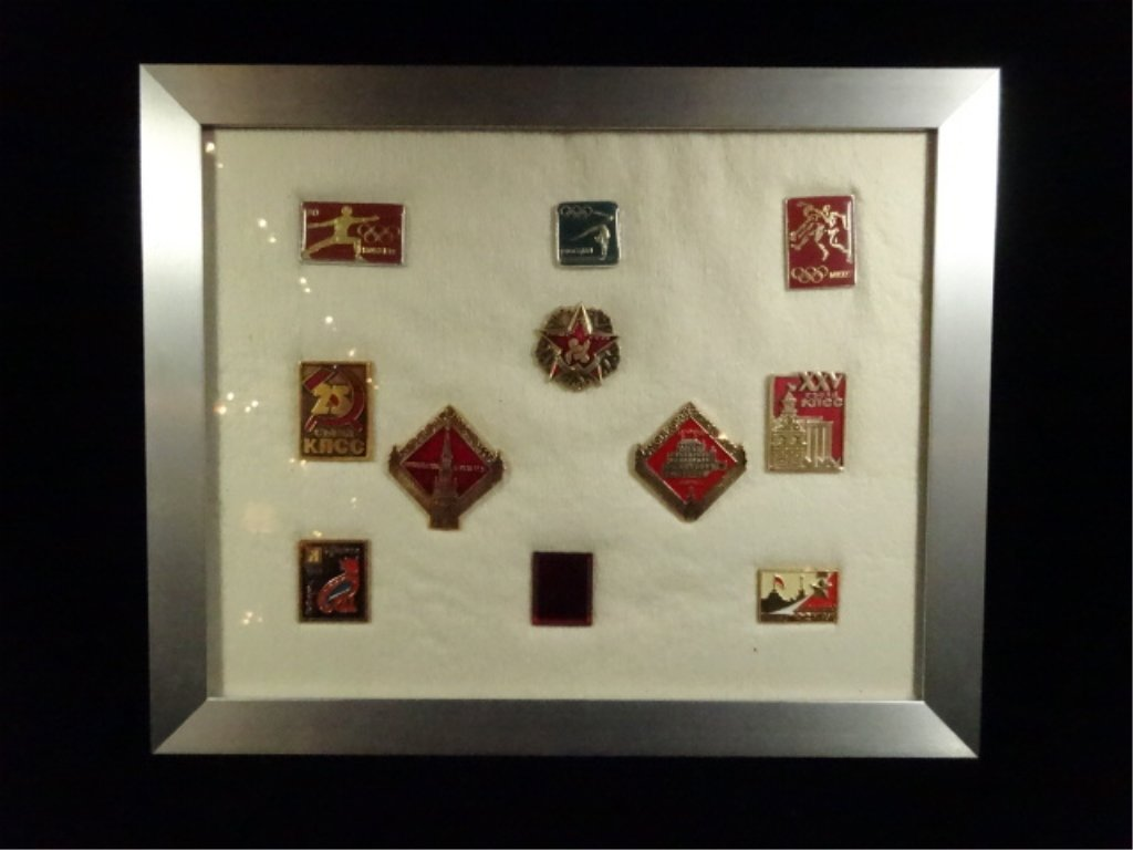 11 FRAMED RUSSIAN PINS, INCLUDES SEVERAL FROM MOSCOW