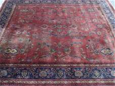 LARGE WOOL PERSIAN STYLE RUG, RED FIELD WITH BLUE AND