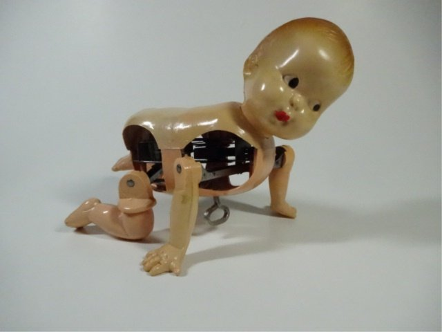 """VINTAGE CRAWLING BABY DOLL, WIND UP, APPROX 4.5""""H"""