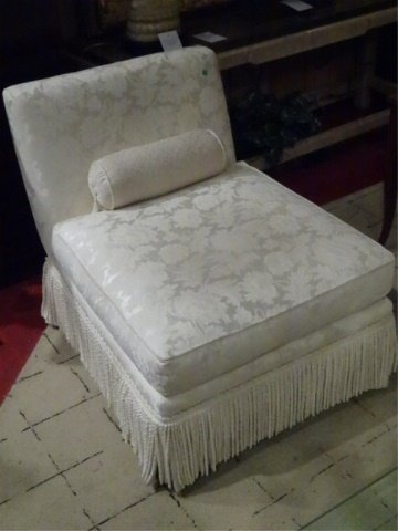 WHITE UPHOLSTERED SLIPPER CHAIR WITH FRINGED BASE,