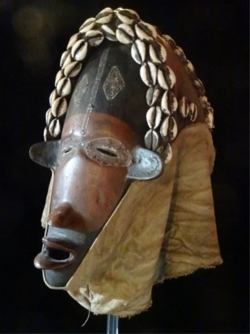 ANTIQUE AFRICAN HELMET MASK, WOOD AND CLOTH WITH COWRIE