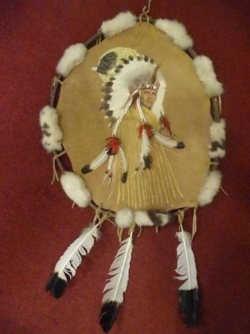 NATIVE AMERICAN PAINTING ON NATURAL HIDE, CHIEF WITH