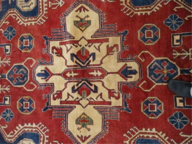 LARGE MIDDLE EASTERN WOOL RUG, RED FIELD WITH BLUE AND - 2