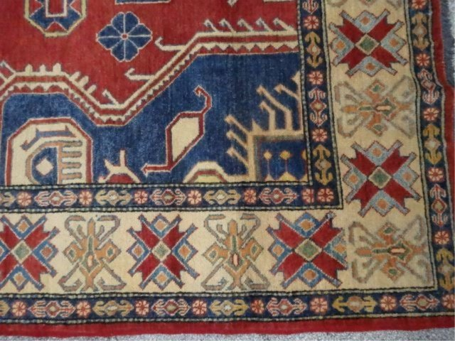 LARGE MIDDLE EASTERN WOOL RUG, RED FIELD WITH BLUE AND - 3