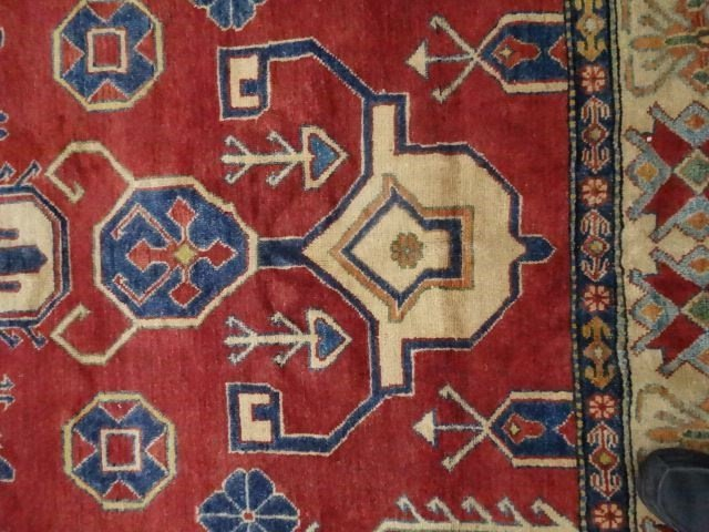LARGE MIDDLE EASTERN WOOL RUG, RED FIELD WITH BLUE AND - 4