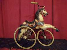 LARGE HORSE ON WHEELS FIGURE METAL AND COMPOSITE BASE