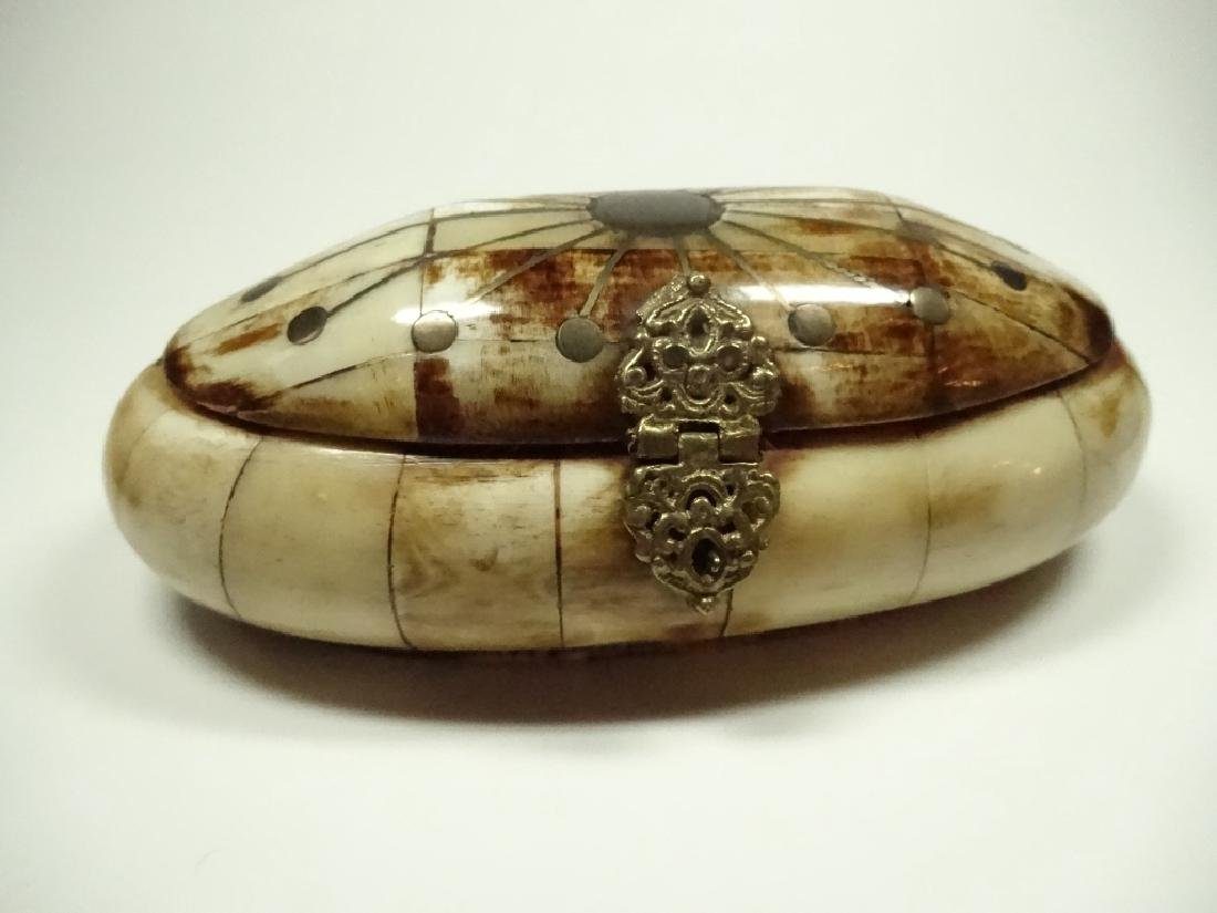 """OVAL CARVED BONE BOX WITH BRASS INLAY, APPROX 6 1/8"""" X"""