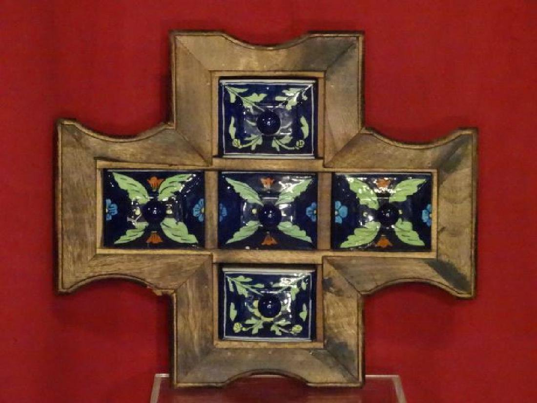 WOOD AND CERAMIC WALL CHEST, CARVED WOOD FRAME WITH