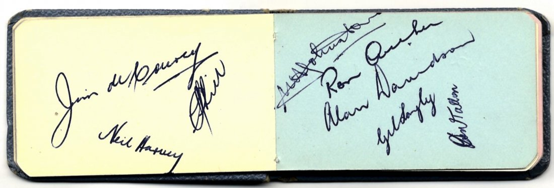 CRICKET: A small 12mo autograph album containing over 4