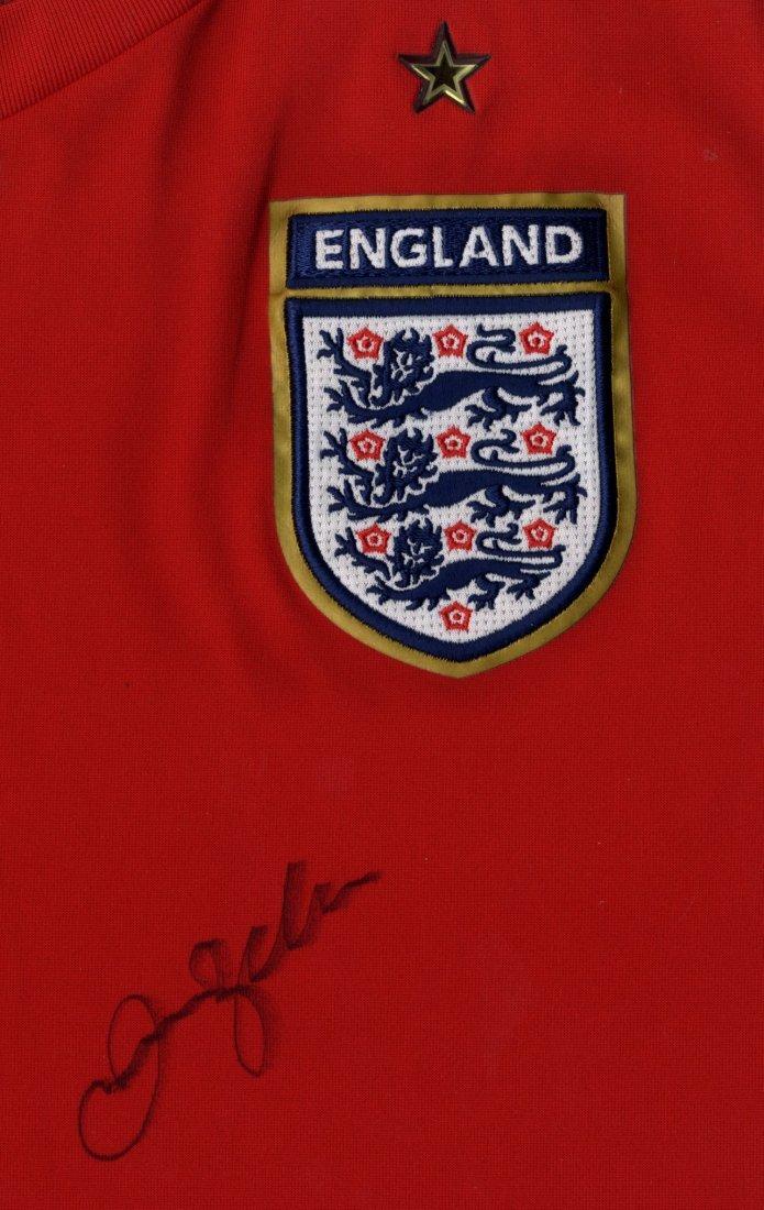 BECKHAM DAVID: (1975- ) English Footballer. An official