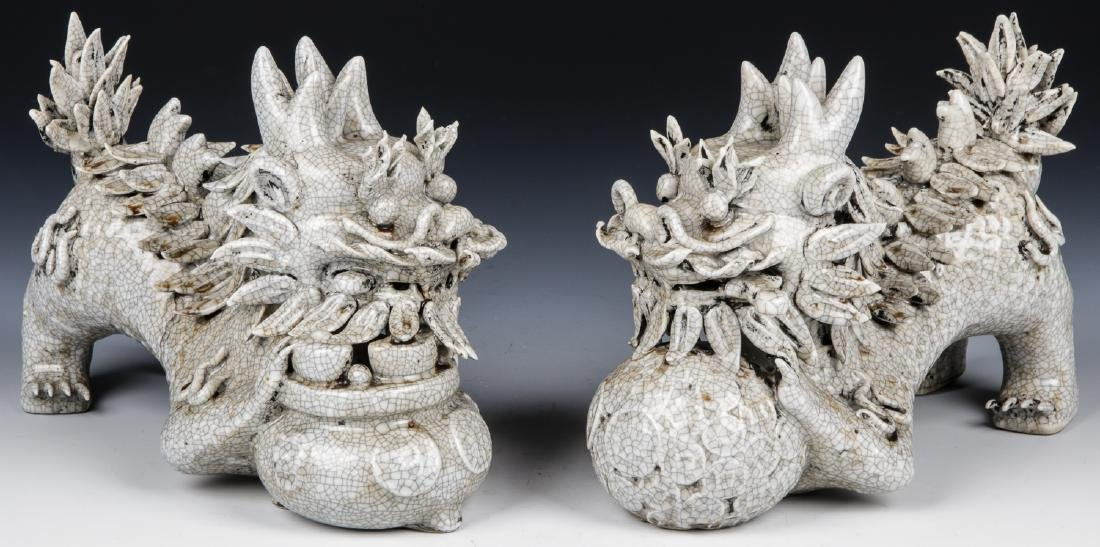 Pair of Chinese White Glaze Ceramic Foo Dogs