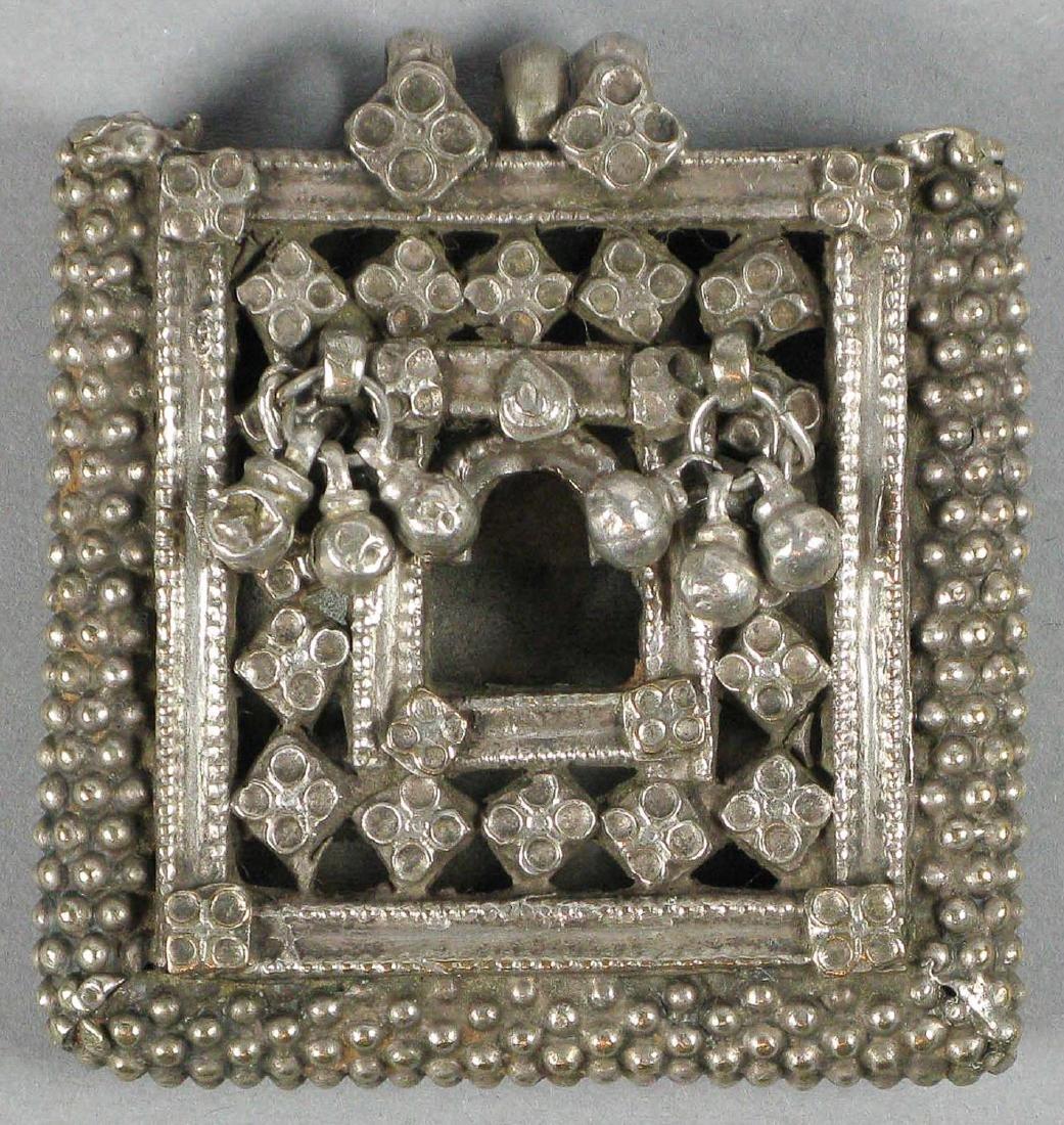 Amulet, India
