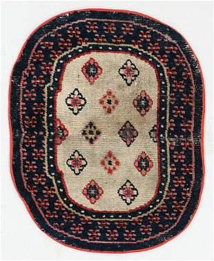 Oval Saddle Rug, Tibet, Late 19th C., 1'11'' x 2'5''