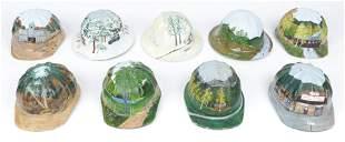 Bob Carpenter (20th c.) Group of 9 Painted Hard Hats