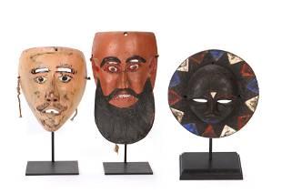 Three Ethnographic Masks on Stands
