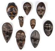 Exemplary Lot of 9 African Passport Masks.