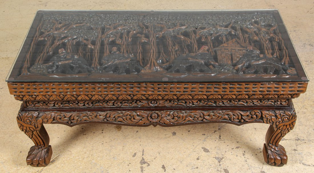 Glass top relief carved asian motif coffee table