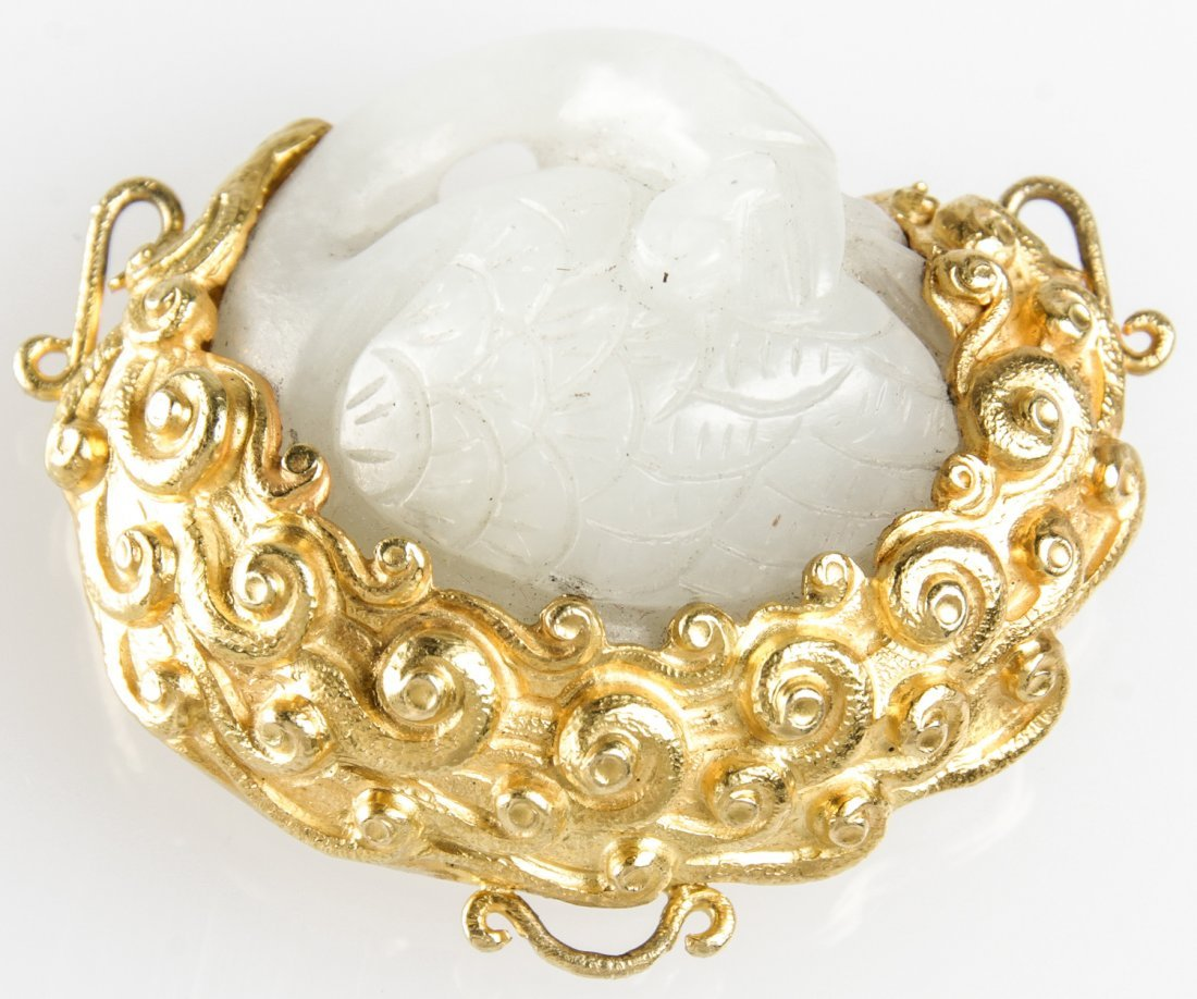 A Chinese White Jade Swan in 18K Gold Wreath