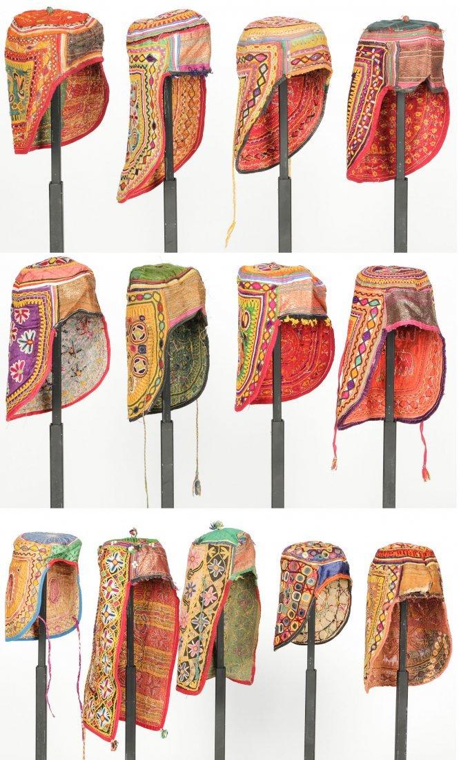 13 Old Rabari Embroidered Children's Hats, India