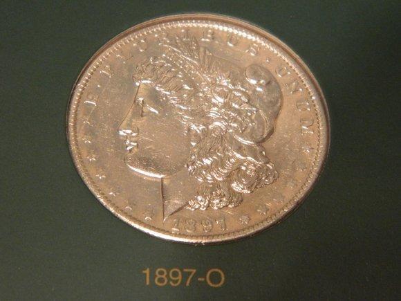 250: 1897-O MS63 Morgan Dollar
