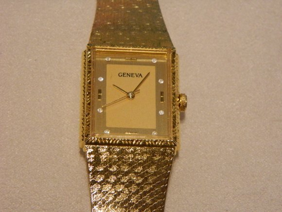 309: 14K Geneva Gold and Diamond Watch