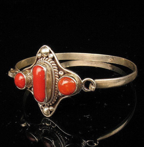5: An Antique Red Coral Inlaid Silver Bracelet