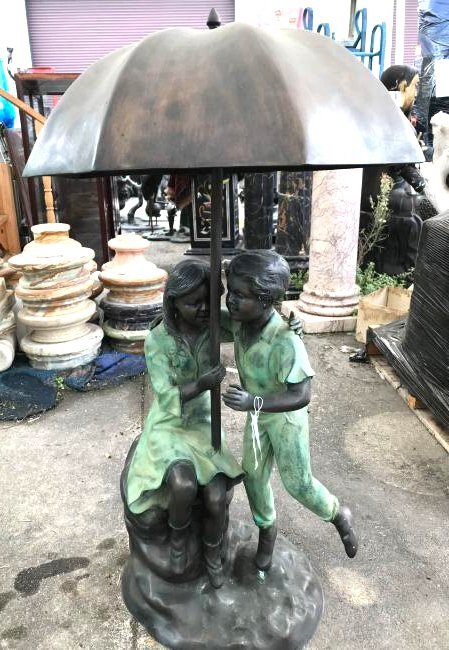 Bronze Fountain of a Boy and Girl Under Umbrella