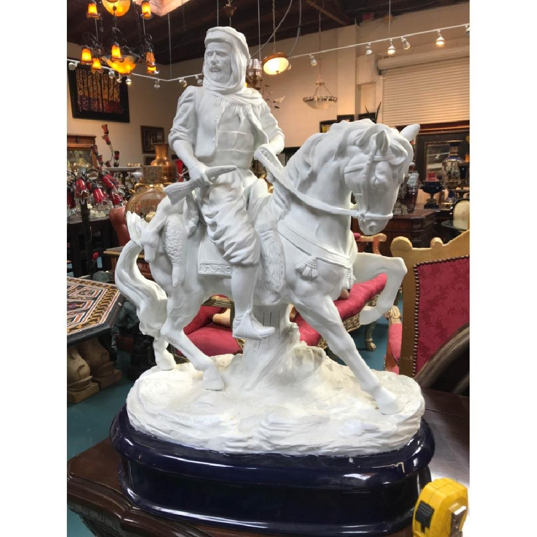 White Bisque Porcelain Statue of a Hunter