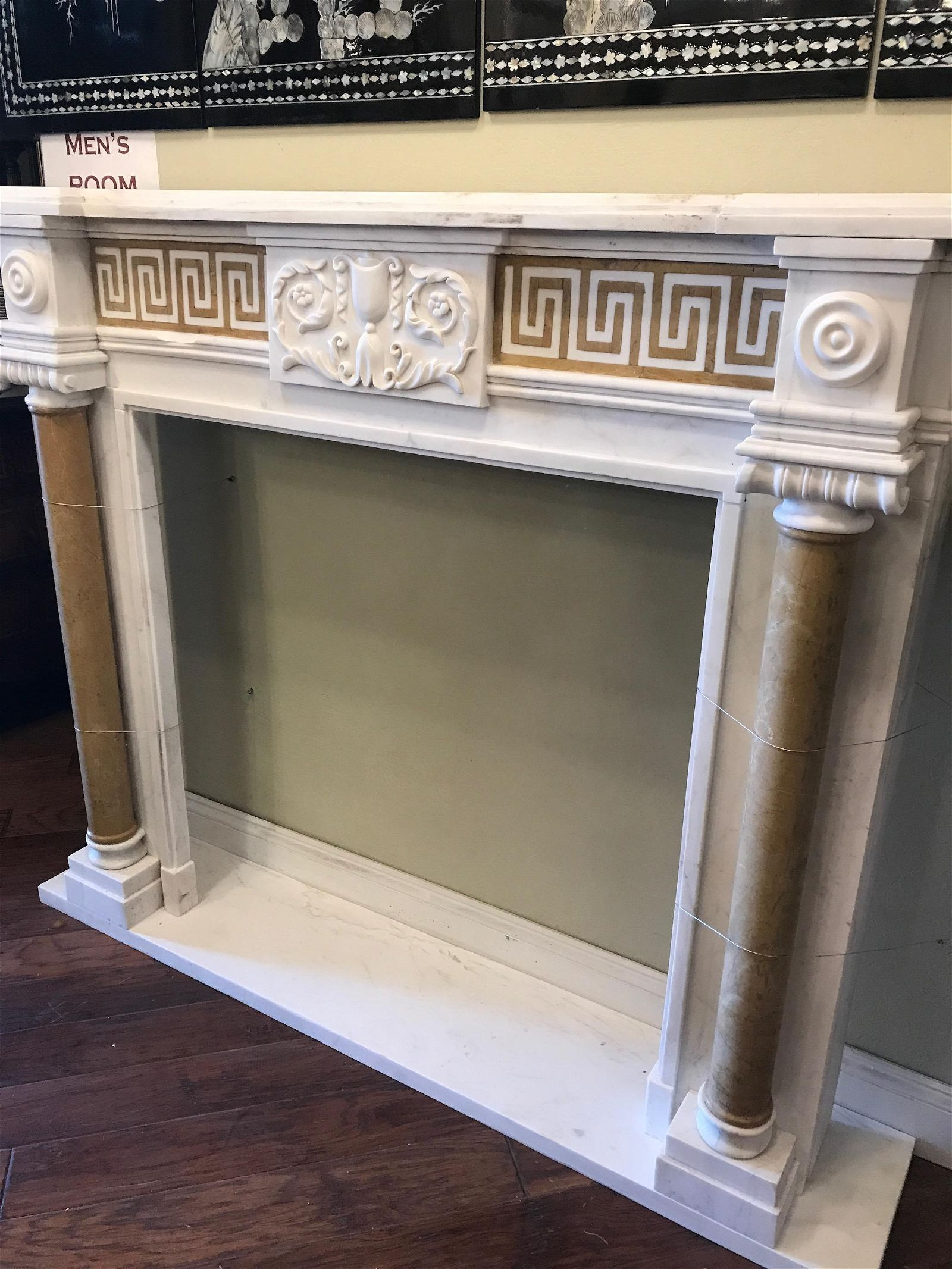 White Marble Fireplace with Tan Accents
