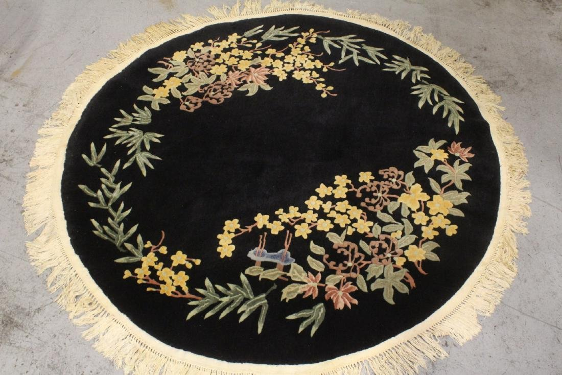 A Chinese hand made black background carpet