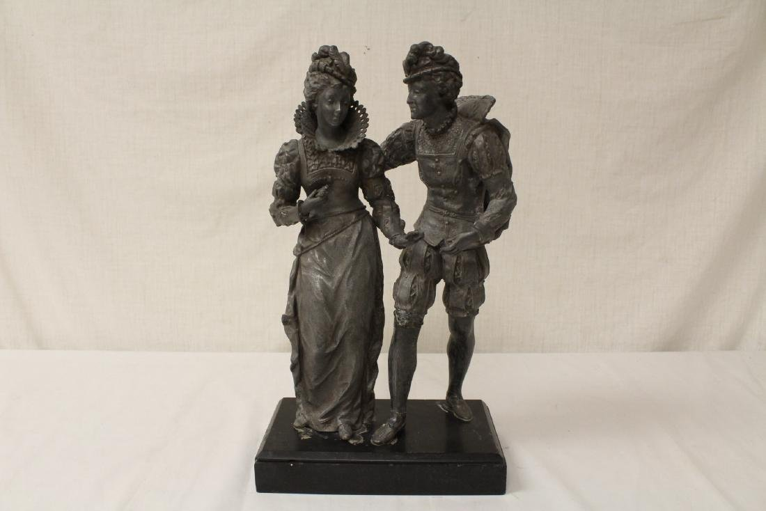 antique spelter sculpture depicting boy and girl