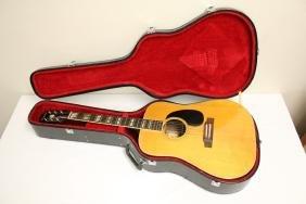 A Coronet acoustic guitar, model 680.D
