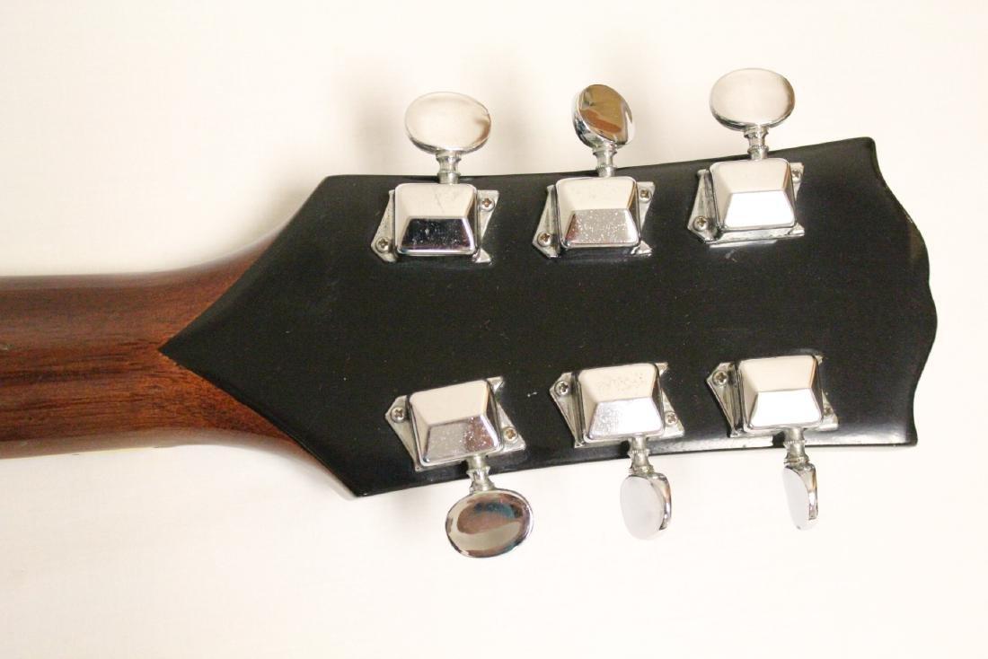 A Coronet acoustic guitar, model 680.D - 9