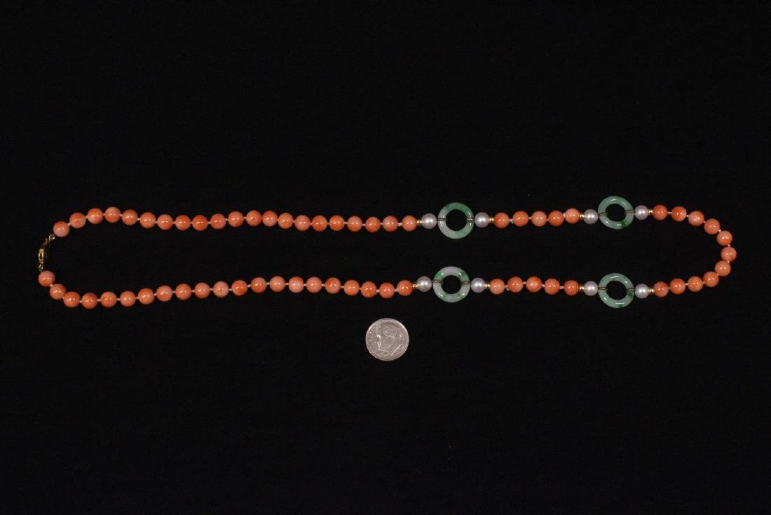 coral necklace w/ jadeite link, pearl & gold beads