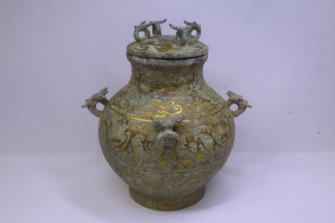 Chinese bronze covered hu with inlaid