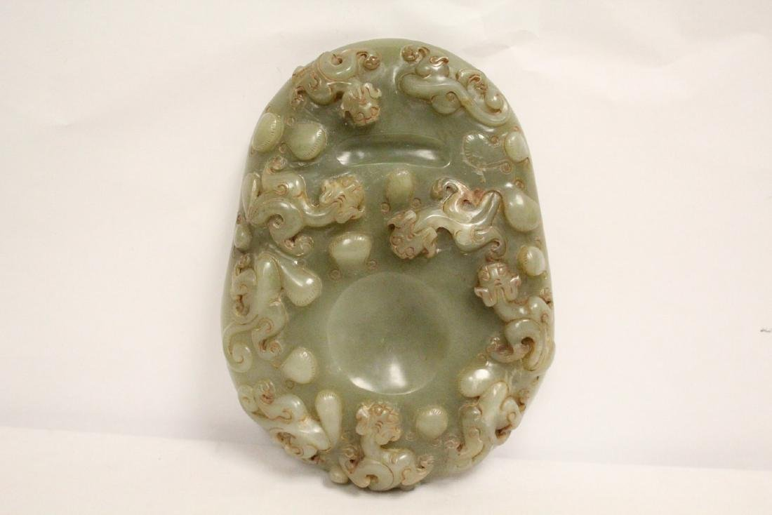 A Chinese celadon jade carved ink slab