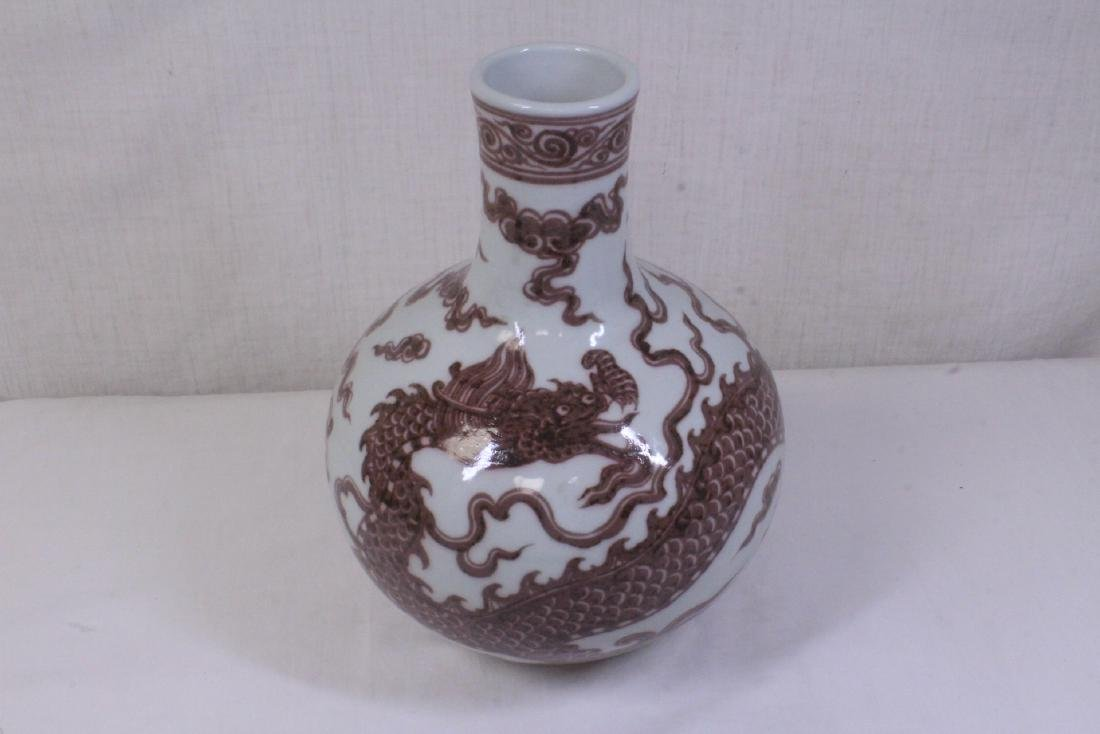 A red and white glazed bottle vase