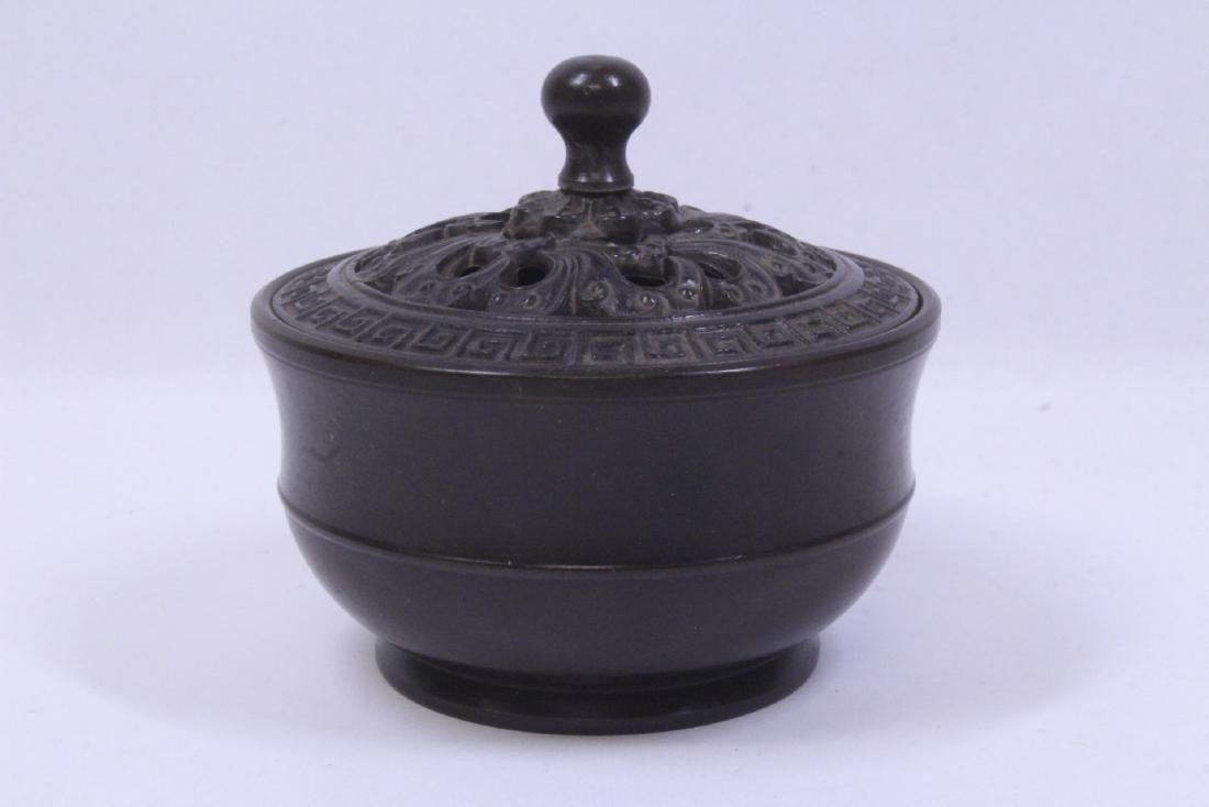 A very heavy small bronze censer