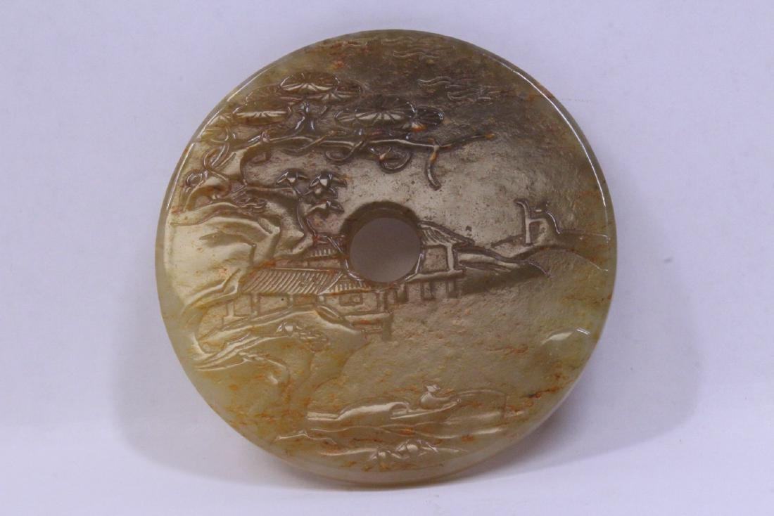 Chinese jade carved pei with landscape in relief