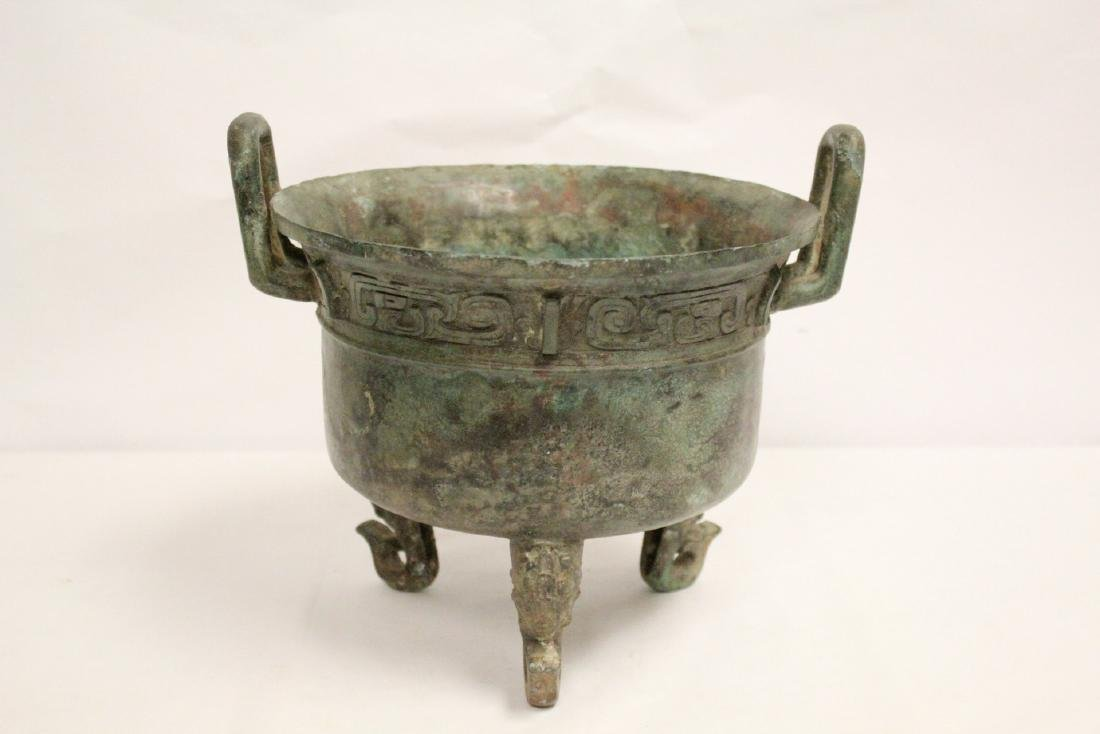A large Chinese archaic style bronze tripod ding