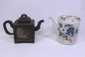 A wucai porcelain teapot and a Yixing teapot